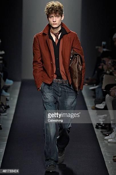 A model walks the runway at the Bottega Veneta Autumn Winter 2015 fashion show during Milan Menswear Fashion Week on January 18 2015 in Milan Italy