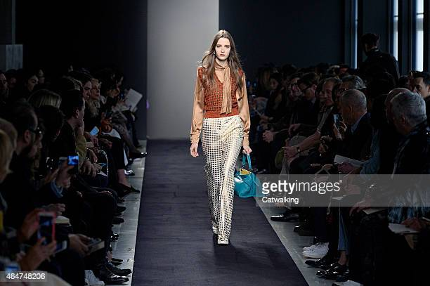A model walks the runway at the Bottega Veneta Autumn Winter 2015 fashion show during Milan Fashion Week on February 28 2015 in Milan Italy