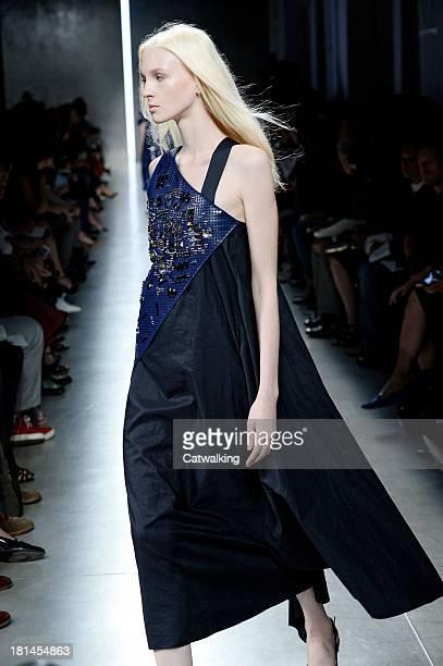 A model walks the runway at the Bottega Veneta Spring Summer 2014 fashion show during Milan Fashion Week on September 21 2013 in Milan Italy