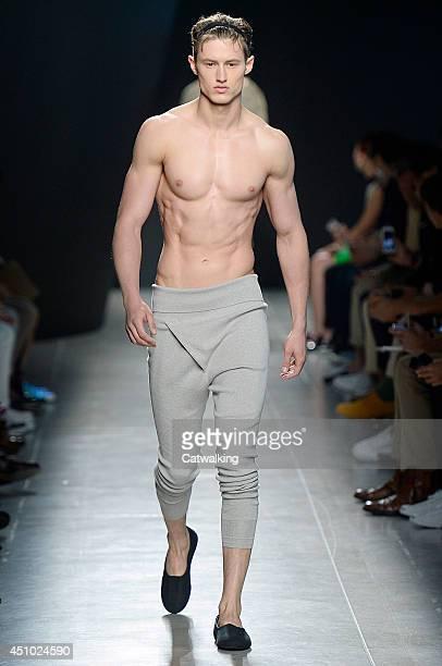 A model walks the runway at the Bottega Veneta Spring Summer 2015 fashion show during Milan Menswear Fashion Week on June 22 2014 in Milan Italy
