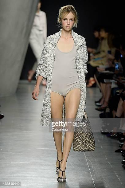 A model walks the runway at the Bottega Veneta Spring Summer 2015 fashion show during Milan Fashion Week on September 20 2014 in Milan Italy