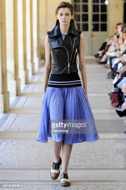 A model walks the runway at the Bouchra Jarrar Autumn Winter 2014 fashion show during Paris Haute Couture Fashion Week on July 8 2014 in Paris France