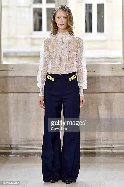 A model walks the runway at the Bouchra Jarrar Spring Summer 2016 fashion show during Paris Haute Couture Fashion Week on January 26 2016 in Paris...