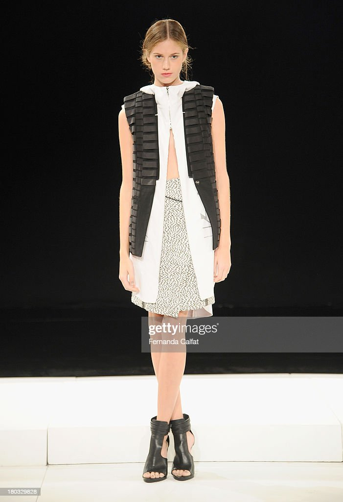 A model walks the runway at the Brandon Sun fashion show during Mercedes-Benz Fashion Week Spring 2014 on September 11, 2013 in New York City.