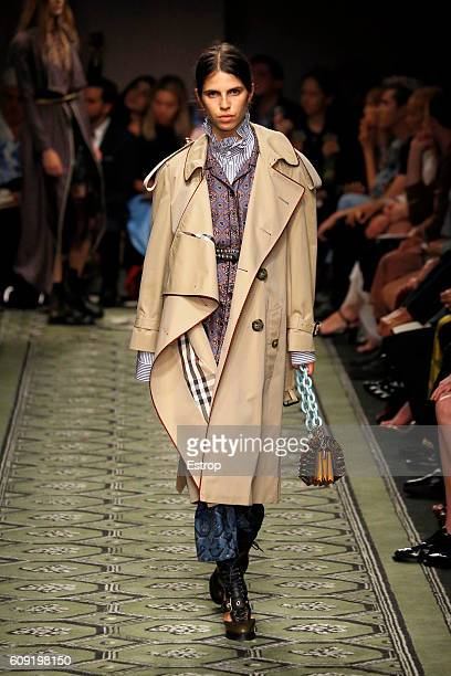 A model walks the runway at the Burberry designed by Christopher Kane show during London Fashion Week Spring/Summer collections 2017 on September 19...