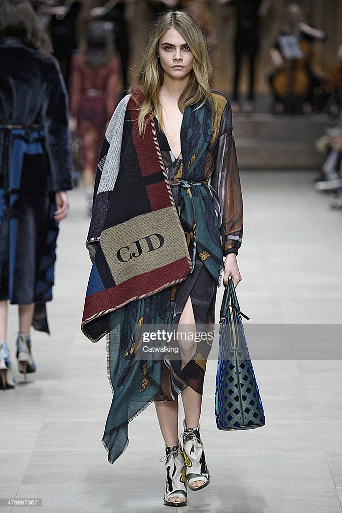 A model walks the runway at the Burberry Prorsum Autumn Winter 2014 fashion show during London Fashion Week on February 17 2014 in London United...