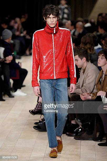 A model walks the runway at the Burberry Prorsum Autumn Winter 2016 fashion show during London Menswear Fashion Week on January 11 2016 in London...