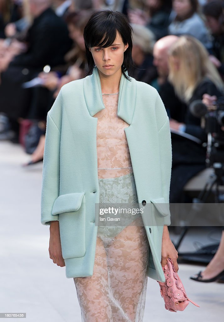 A model walks the runway at the Burberry Prorsum show at London Fashion Week SS14 at Kensington Gardens on September 16, 2013 in London, England.