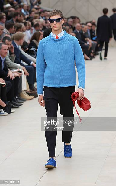 A model walks the runway at the Burberry Prorsum show at the London Collections MEN SS14 at Kensington Gardens on June 18 2013 in London England