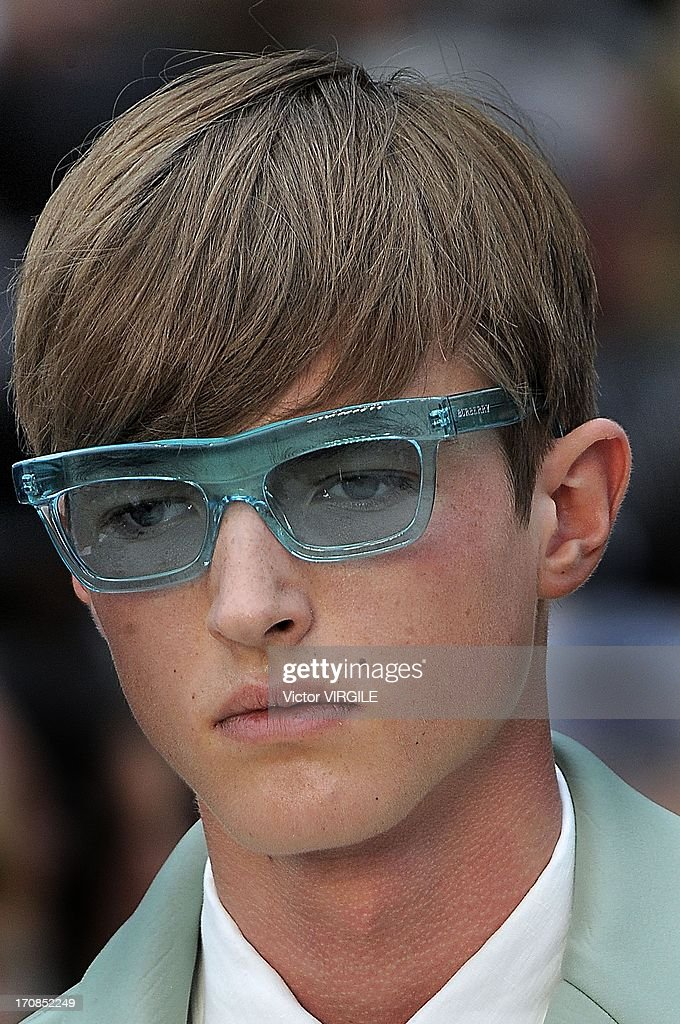 A model walks the runway at the Burberry Prorsum show at the London Collections: MEN Spring Summer 2014 at Kensington Gardens on June 18, 2013 in London, England.