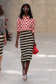 A model walks the runway at the Burberry Prorsum show during London Fashion Week SS14 at on September 16 2013 in London England