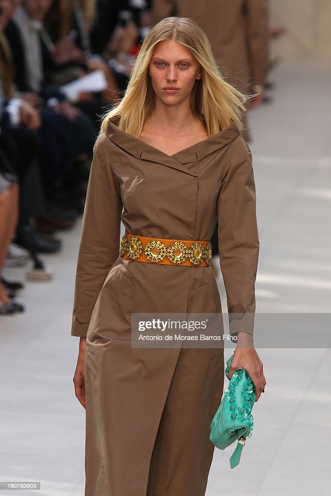 A model walks the runway at the Burberry Prorsum show during London Fashion Week SS14 at on September 16, 2013 in London, England.A model walks the runway at the Burberry Prorsum show during London Fashion Week SS14 at on September 16, 2013 in London, England.