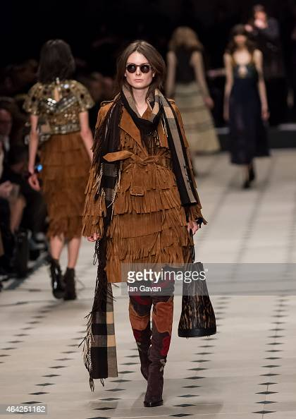 A model walks the runway at the Burberry Prorsum show during London Fashion Week Fall/Winter 2015/16 at perk's Field on February 23 2015 in London...