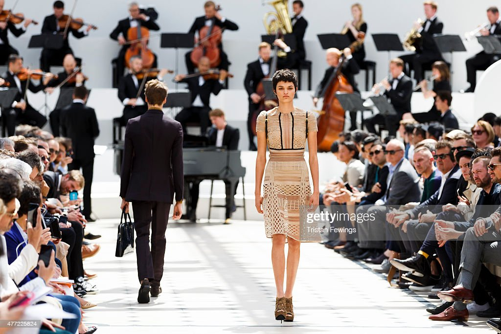 A model walks the runway at the Burberry Prorsum show during The London Collections Men SS16 at Kensington Gardens on June 15 2015 in London England