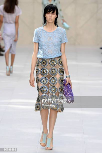 A model walks the runway at the Burberry Prorsum Spring Summer 2014 fashion show during London Fashion Week on September 16 2013 in London United...