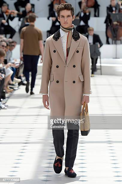 A model walks the runway at the Burberry Prorsum Spring Summer 2016 fashion show during London Menswear Fashion Week on June 15 2015 in London United...