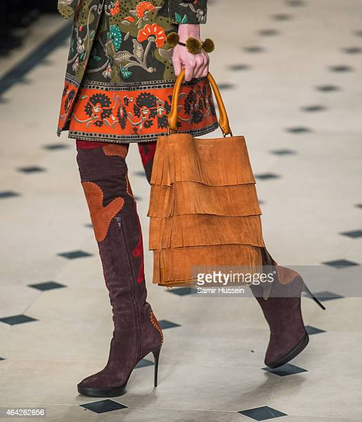 A model walks the runway at the Burberry Prosum show during London Fashion Week Fall/Winter 2015/16 at perk's Field on February 23 2015 in London...