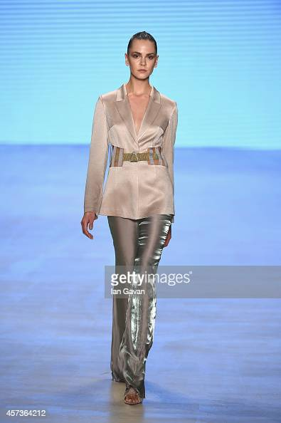 A model walks the runway at the Burce Bekrek show during Mercedes Benz Fashion Week Istanbul SS15 at Antrepo 3 on October 17 2014 in Istanbul Turkey