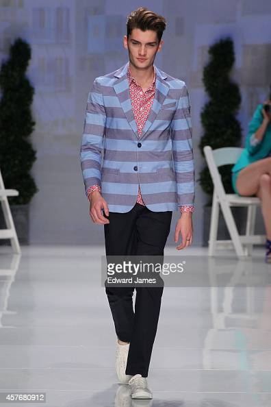 A model walks the runway at the Bustle Spring/Summer 2015 fashion show during World Mastercard Fashion Week at David Pecaut Square on October 21 2014...