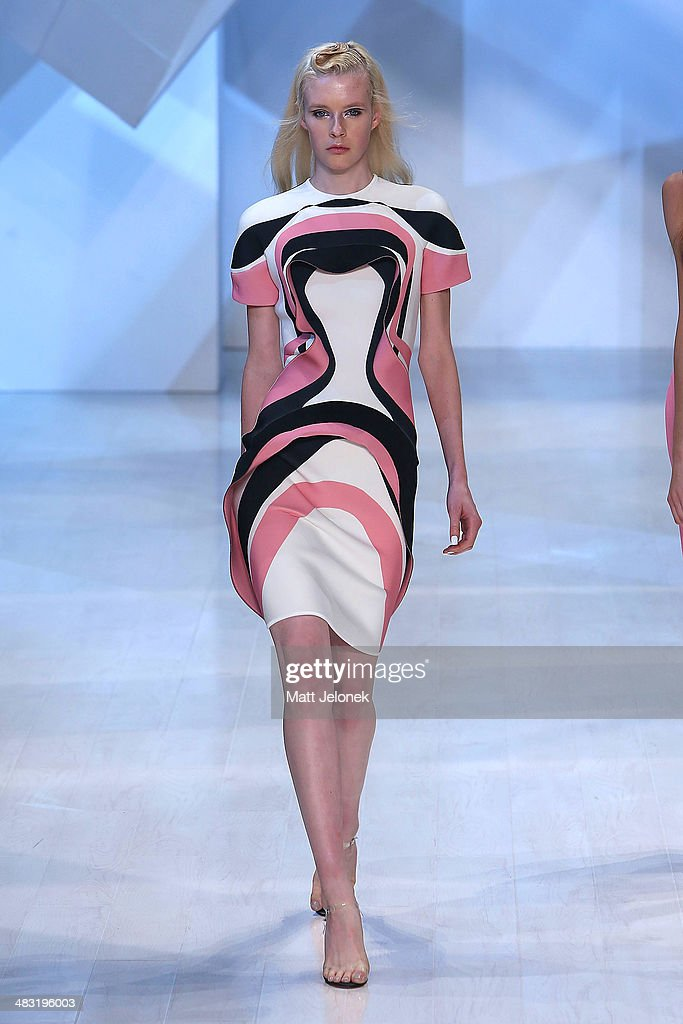 A model walks the runway at the By Johnny show during Mercedes-Benz Fashion Week Australia 2014 at Carriageworks on April 7, 2014 in Sydney, Australia.