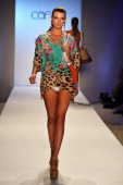 A model walks the runway at the Caffe Swimwear show during MercedesBenz Fashion Week Swim 2014 at Oasis at the Raleigh on July 21 2013 in Miami...