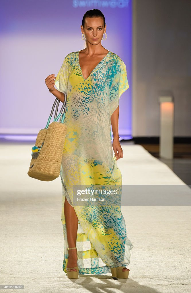 A model walks the runway at the Caffe Swimwear SS16 Collection during SWIMMIAMI at W South Beach WET on July 18 2015 in Miami Beach Florida