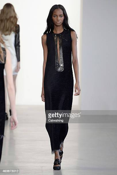 A model walks the runway at the Calvin Klein Autumn Winter 2015 fashion show during New York Fashion Week on February 19 2015 in New York United...