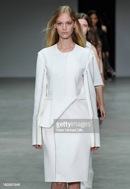 A model walks the runway at the Calvin Klein Collection fashion show during MercedesBenz Fashion Week Spring 2014 at Spring Studios on September 12...