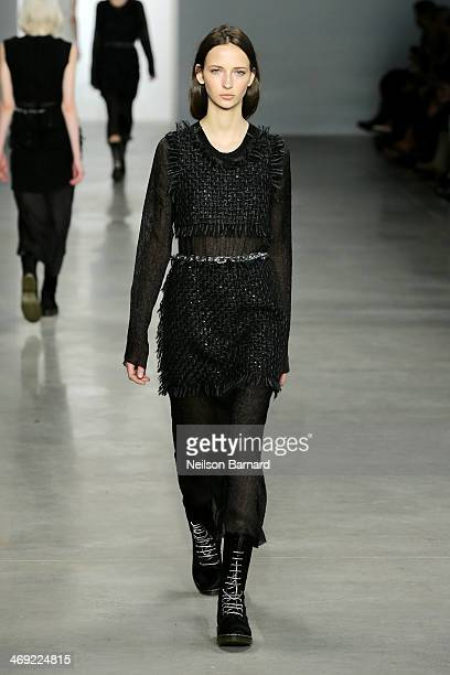 A model walks the runway at the Calvin Klein Collection fashion show during MercedesBenz Fashion Week Fall 2014 at Spring Studios on February 13 2014...