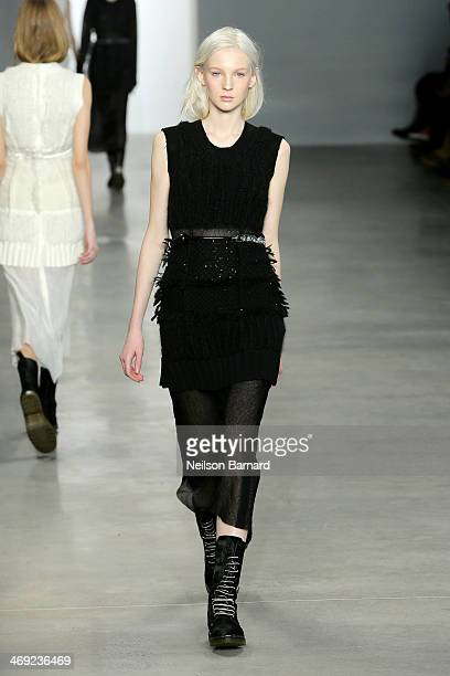 A model walks the runway at the Calvin Klein Collection fashion show during MercedesBenz Fashion Week Fall 2014 on February 13 2014 in New York City