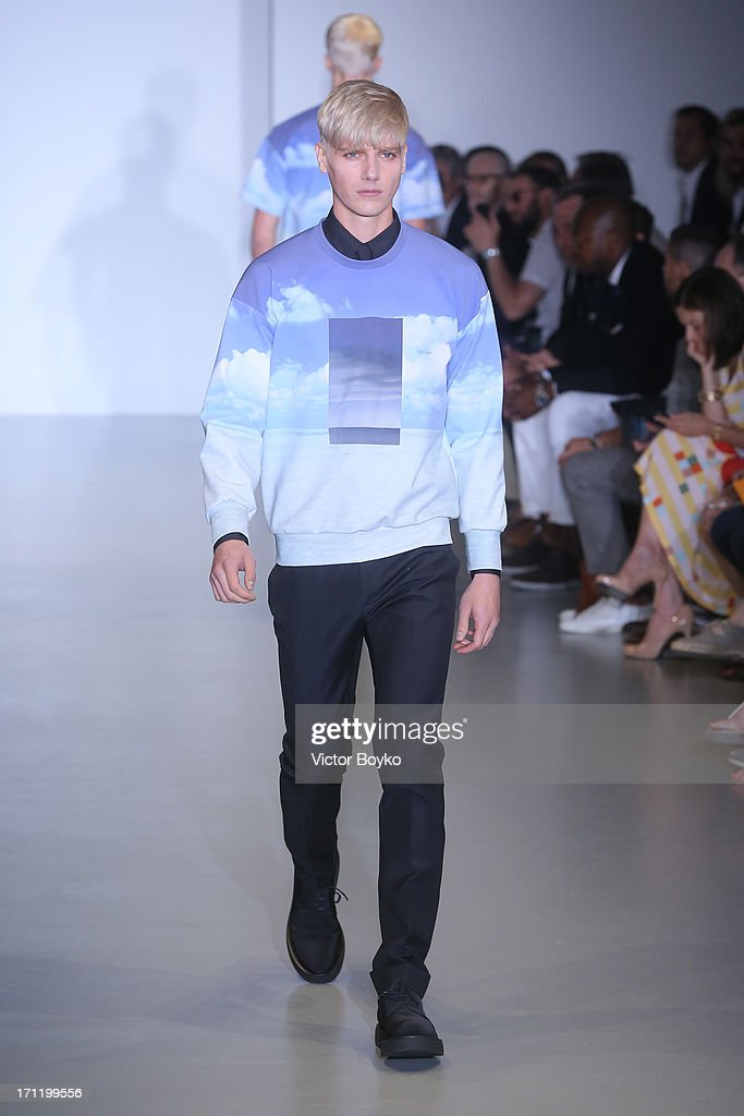 A model walks the runway at the Calvin Klein Collection show during Milan Menswear Fashion Week Spring Summer 2014 on June 23, 2013 in Milan, Italy.