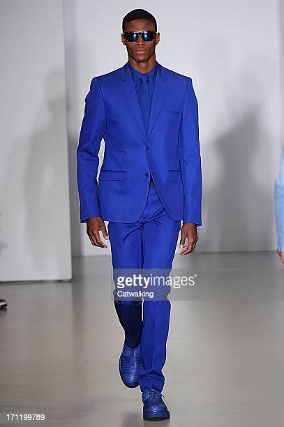 A model walks the runway at the Calvin Klein Spring Summer 2014 fashion show during Milan Menswear Fashion Week on June 23 2013 in Milan Italy