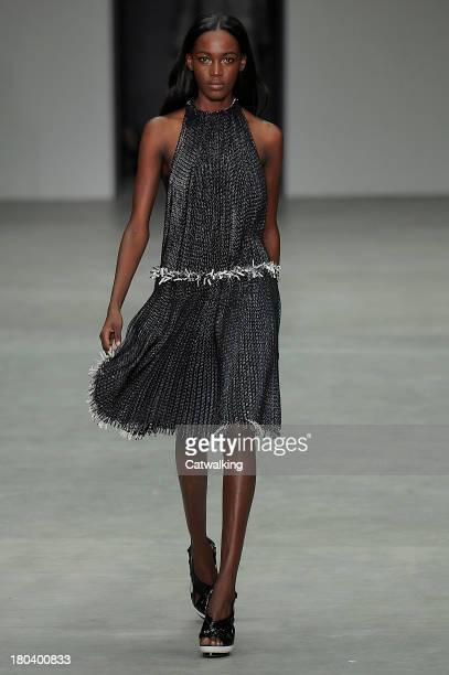 A model walks the runway at the Calvin Klein Spring Summer 2014 fashion show during New York Fashion Week on September 12 2013 in New York United...