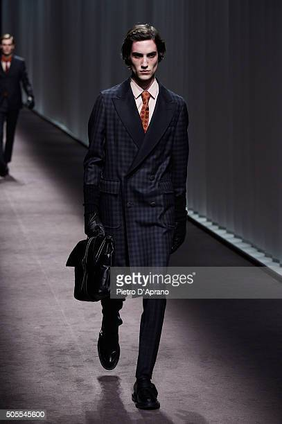 A model walks the runway at the Canali show during Milan Men's Fashion Week Fall/Winter 2016/17 on January 18 2016 in Milan Italy