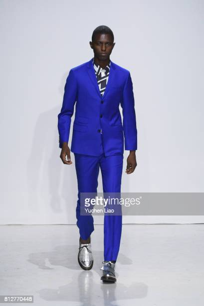 A model walks the runway at the Carlos Campos show during NYFW Mens Spring Summer 2018 at Skylight Clarkson Sq on July 11 2017 in New York City