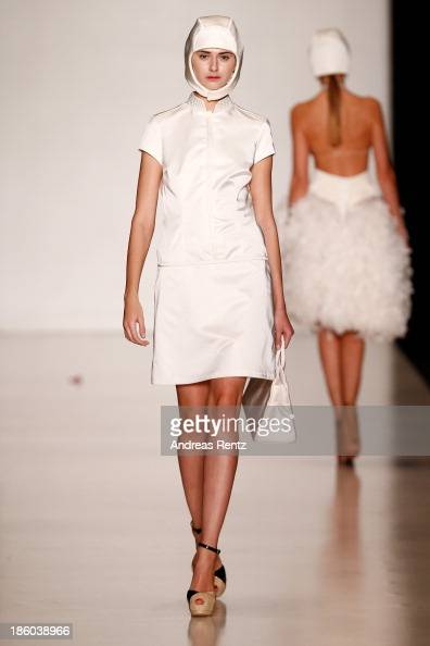 A model walks the runway at the Carmen Emanuela Popa show during MercedesBenz Fashion Week Russia S/S 2014on October 27 2013 in Moscow Russia