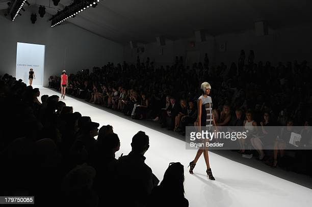 A model walks the runway at the Carmen Marc Valvo Spring 2014 fashion show during MercedesBenz Fashion Week at The Stage at Lincoln Center on...