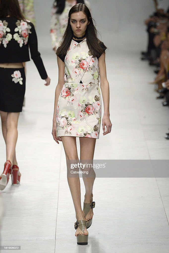 A model walks the runway at the Carven Spring Summer 2014 fashion show during Paris Fashion Week on September 26, 2013 in Paris, France.