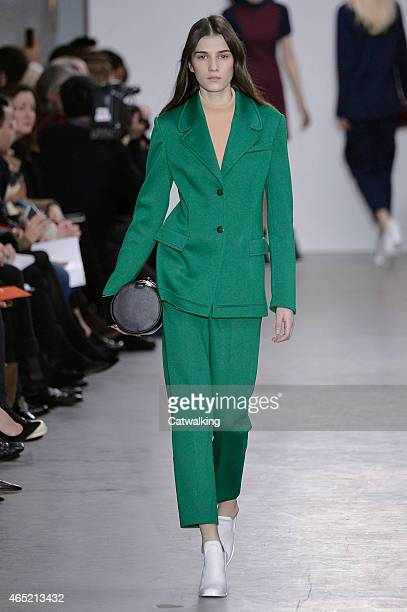 A model walks the runway at the Cedric Charlier Autumn Winter 2015 fashion show during Paris Fashion Week on March 4 2015 in Paris France