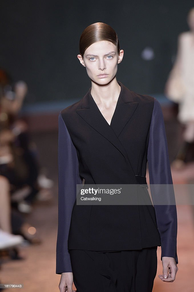 A model walks the runway at the Cedric Charlier Spring Summer 2014 fashion show during Paris Fashion Week on September 24, 2013 in Paris, France.