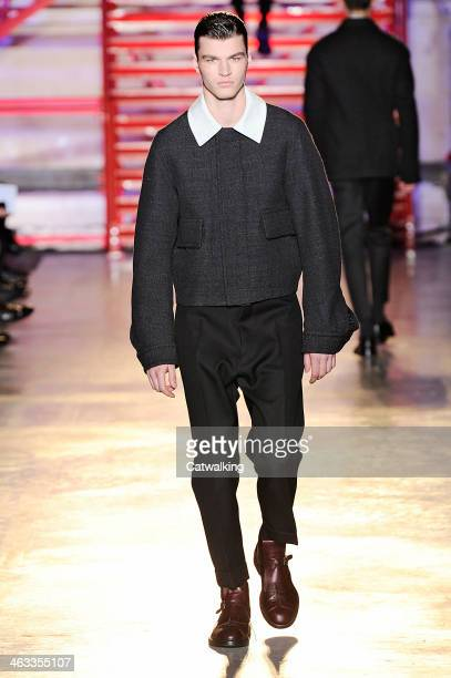 A model walks the runway at the Cerruti Autumn Winter 2014 fashion show during Paris Menswear Fashion Week on January 17 2014 in Paris France