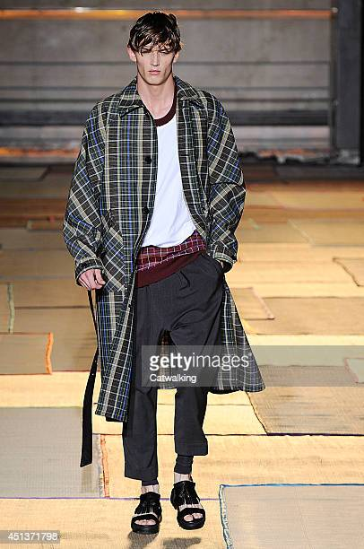 A model walks the runway at the Cerruti Spring Summer 2015 fashion show during Paris Menswear Fashion Week on June 27 2014 in Paris France
