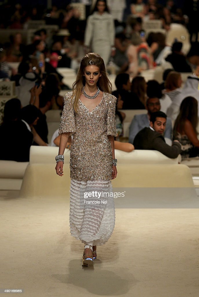 A model walks the runway at the Chanel Cruise Collection 2014/2015 at The Island on May 13 2014 in Dubai United Arab Emirates