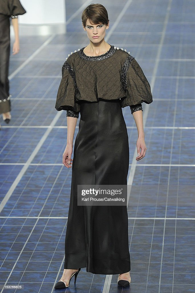 A model walks the runway at the Chanel Spring Summer 2013 fashion show during Paris Fashion Week on October 2, 2012 in Paris, France.