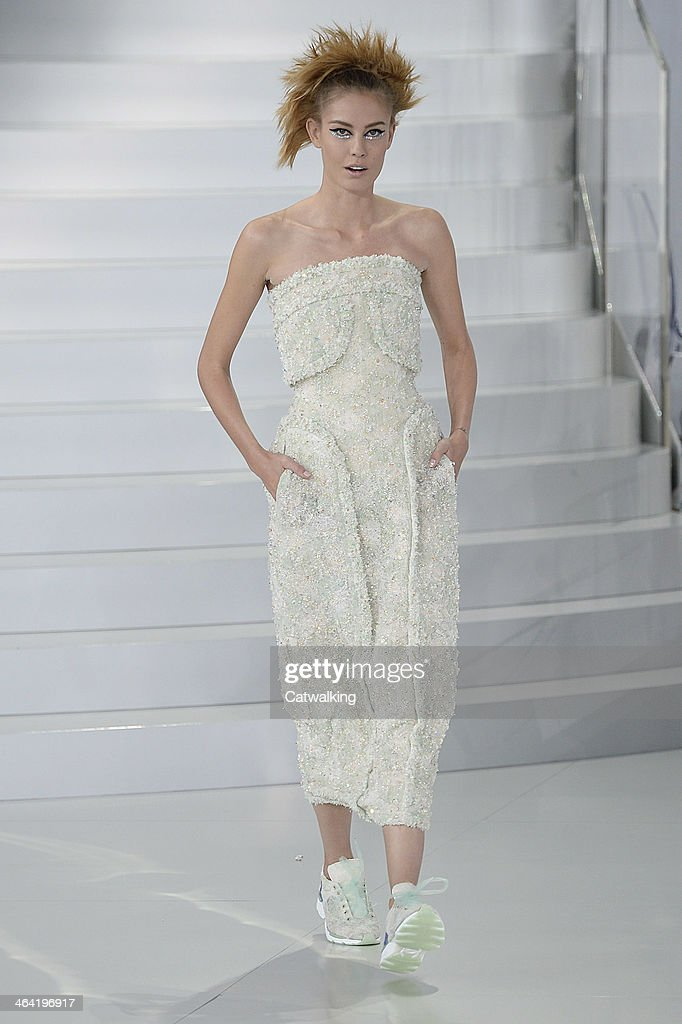 A model walks the runway at the Chanel Spring Summer 2014 fashion show during Paris Haute Couture Fashion Week on January 21 2014 in Paris France