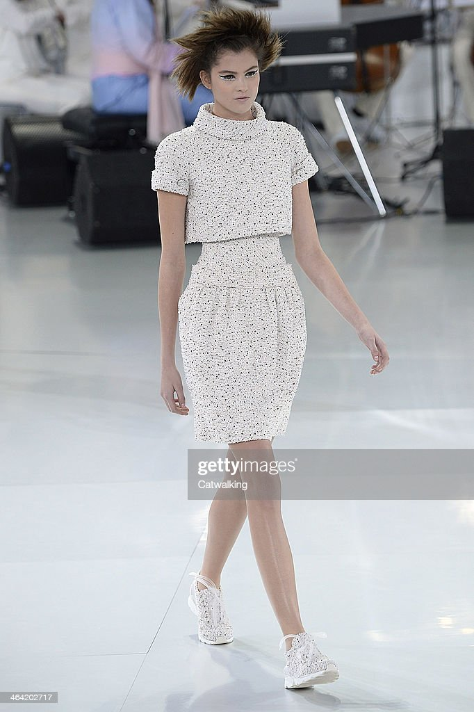 A model walks the runway at the Chanel Spring Summer 2014 fashion show during Paris Haute Couture Fashion Week on January 21, 2014 in Paris, France.