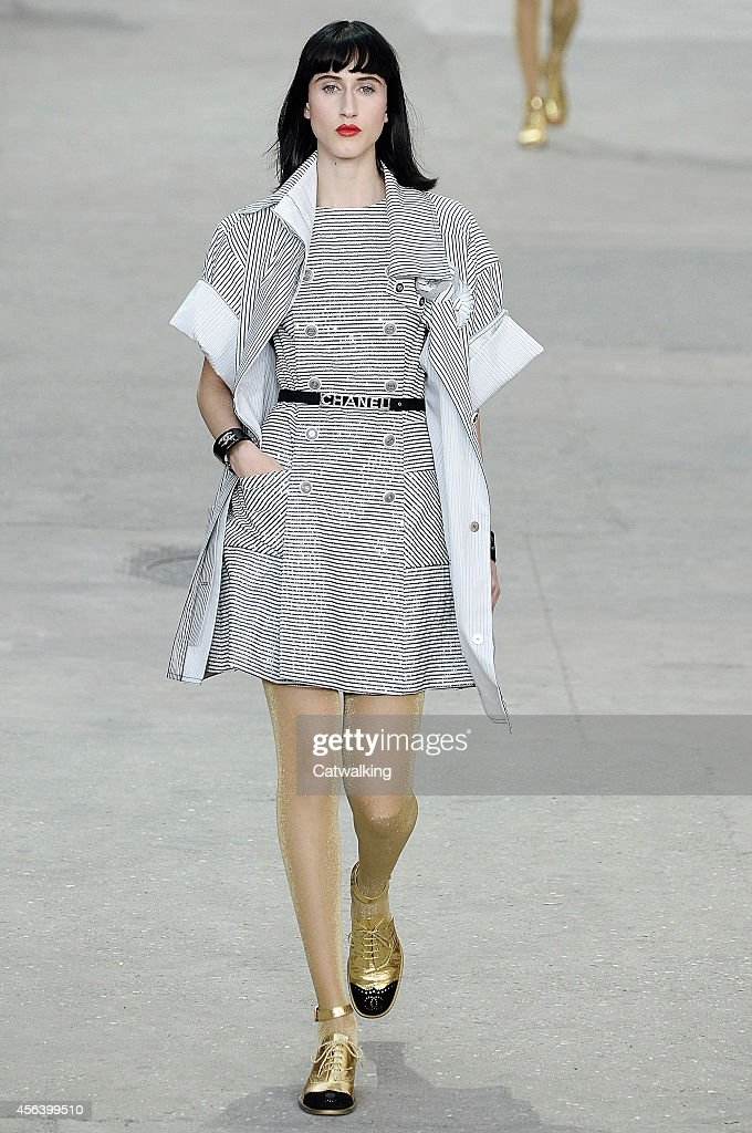 A model walks the runway at the Chanel Spring Summer 2015 fashion show during Paris Fashion Week on September 30 2014 in Paris France