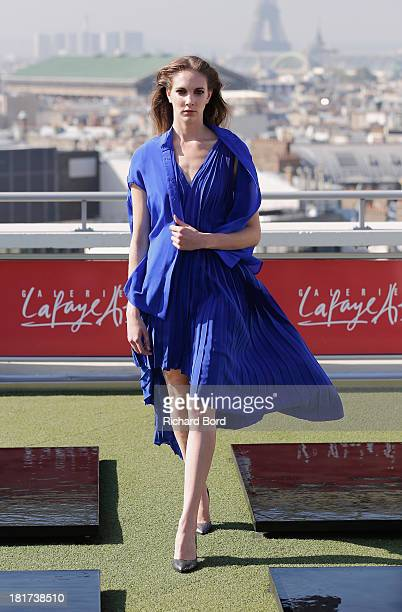 A model walks the runway at the Christine Phung show as part of the Paris Fashion Week Womenswear Spring/Summer 2014 at Galleries Lafayette on...