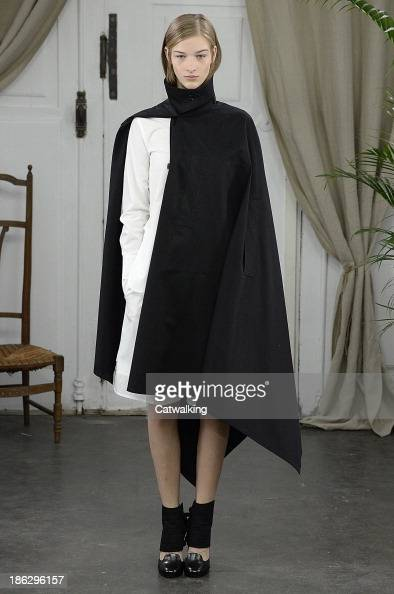A model walks the runway at the Christophe Lemaire Spring Summer 2014 fashion show during Paris Fashion Week on September 25 2013 in Paris France