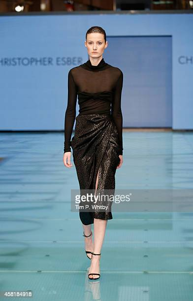 A model walks the runway at the Christopher Esber during the Vogue Fashion Dubai Experience on October 30 2014 in Dubai United Arab Emirates